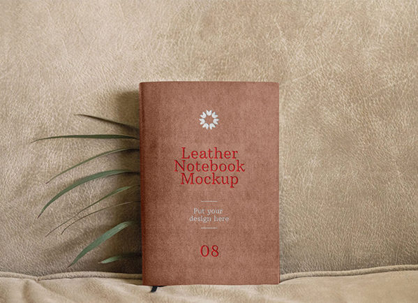 mockup of leather book on the brown background